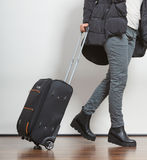 Woman in warm jacket with suitcase. Stock Images