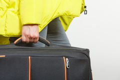 Woman in warm jacket with suitcase. Royalty Free Stock Images