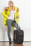 Woman in warm jacket with suitcase. Stock Photography