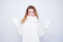Woman  in  warm knitted scarf and gloves happy Royalty Free Stock Image