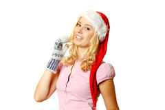 Woman in warm mittens and a red Santa Claus hat Royalty Free Stock Photo
