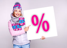 Woman in warm outerwear  holds the banner with perсent symbol Royalty Free Stock Images