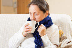 Woman in warm scarf with hot cup Royalty Free Stock Photos