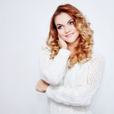 Woman in warm sweater, portrait on  white background, place for your text Royalty Free Stock Photos