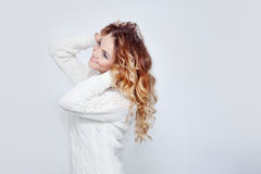 Woman in warm sweater, portrait on  white Stock Photography