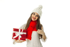 Woman in warm sweater and red scarf Stock Photo