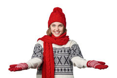 Woman in warm winter clothing with opened arms salutating Royalty Free Stock Photography