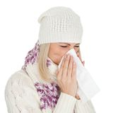 Woman in warm winter clothing sneezing from cold Stock Images