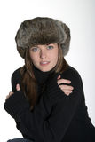 Woman in warm winter hat. Woman in fur hat with sexy look Stock Photos