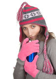 Woman in warm winter hat with blue cup Royalty Free Stock Photo