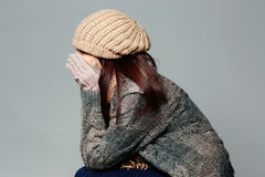 Woman in warm winter outfit on gray background Stock Photos