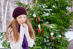 Woman warming hands outdoors in winter Stock Photos