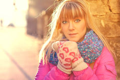 Woman warming her hands in mittens Stock Photos