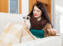 Woman warming near electric heater Royalty Free Stock Photography
