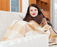 Woman warming near electric heater Royalty Free Stock Photos