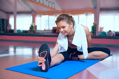 Woman warming up in fitness club Stock Image