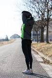 Woman warming-up before her running Stock Image