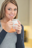 Woman warming up with a hot beverage Royalty Free Stock Image