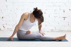 Woman warming up during sport practice Stock Photography