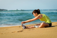 Woman warming up stretching leg Royalty Free Stock Photography