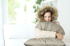 Woman warmly clothed in a cold home royalty free stock photo