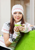 Woman warms with cup of tea Stock Image