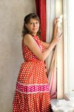 The woman warms windows. Cotton wool stock image