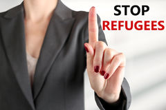 Woman warning. Stop refugees. Gray background behind Stock Photos