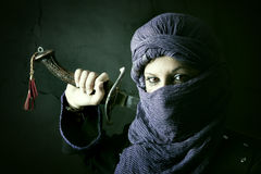 Woman warrior. Arabic Woman warrior portrait against a dark background Royalty Free Stock Image