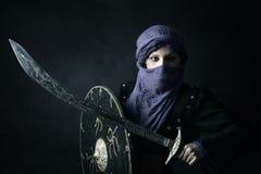 Woman warrior. Arabic Woman warrior portrait against a dark background Stock Photography