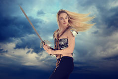 Woman warrior with cloudy sky background Stock Photography