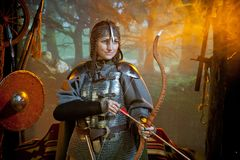 Woman in warrior costume. A smilingwoman in the costume of a warrior of the times of Kiev Rus in chain mail with a bow and arrows Stock Images