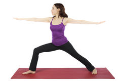 Woman in Warrior II Pose during Yoga stock image