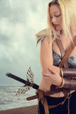 Woman warrior by the ocean on beach Royalty Free Stock Photography