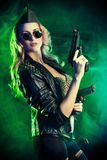 Woman warrior. Portrait of a beautiful woman posing in a military style over dark background Stock Photos
