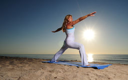 Woman in Warrior Pose II Yoga pose Stock Photography