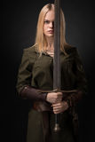 Woman warrior with sword. In hand on gray background royalty free stock photos