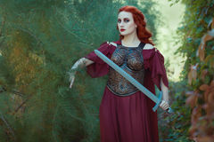 Woman warrior with a sword in her hand. Royalty Free Stock Images