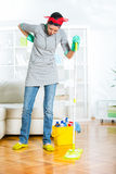 Woman was aching back while cleaning the floor Stock Photos