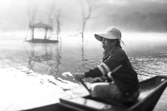 A Woman was paddling a boat. On the river Royalty Free Stock Image