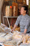 Woman was promoting the dried seafood Stock Images