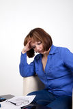 The woman was tired. Sits at a table, has removed glasses Stock Images