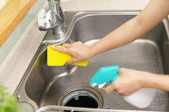Woman wash the kitchen sink. Woman hands washing the kitchen sink stock images