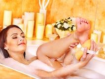 Woman wash leg in bathtube. Young woman wash leg in bathtube royalty free stock image