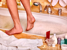 Woman wash leg in bathtube Royalty Free Stock Photography