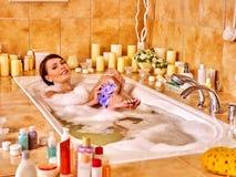 Woman wash leg in bathtube. Girl wash leg in bathtube. Women take bath stock photography