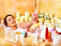 Woman wash leg in bathtube. Royalty Free Stock Photos