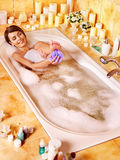 Woman wash leg in bathtube. Royalty Free Stock Images