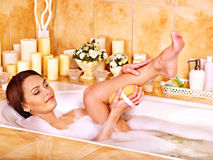 Woman wash leg in bathtube. Royalty Free Stock Photo