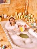 Woman wash leg in bathtube. Young woman wash leg in bathtube stock image